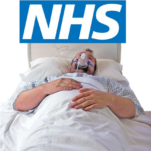 Man with an oxygen mask with the NHS sign